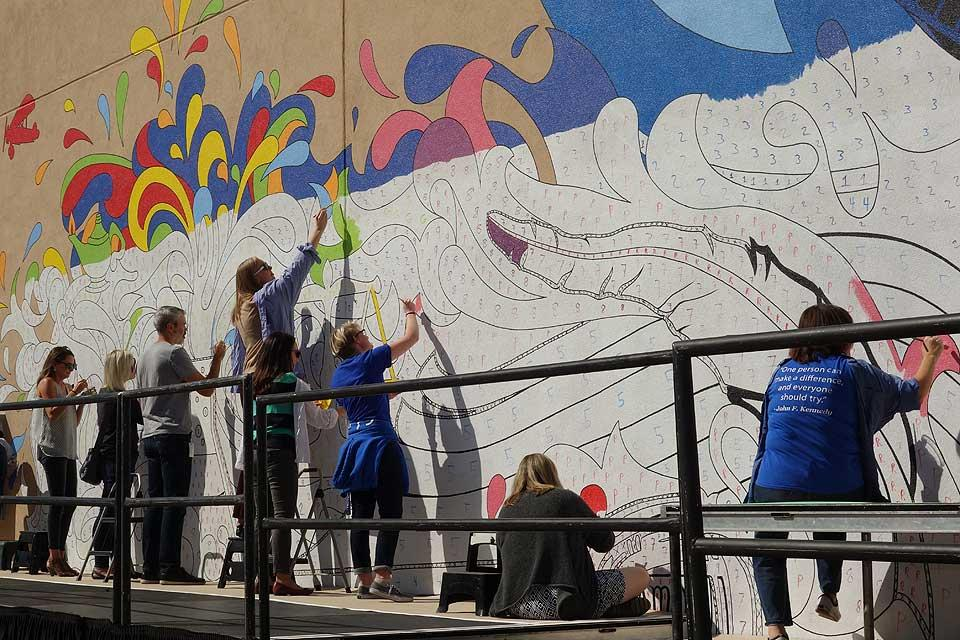 SLU faculty, staff and students paint a section of the Bicentennial mural. Photo by Maggie Rotermund