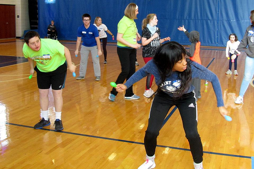 Sophomore Latreecia Evans (right) leads KEEN athletes in grooving to the music.