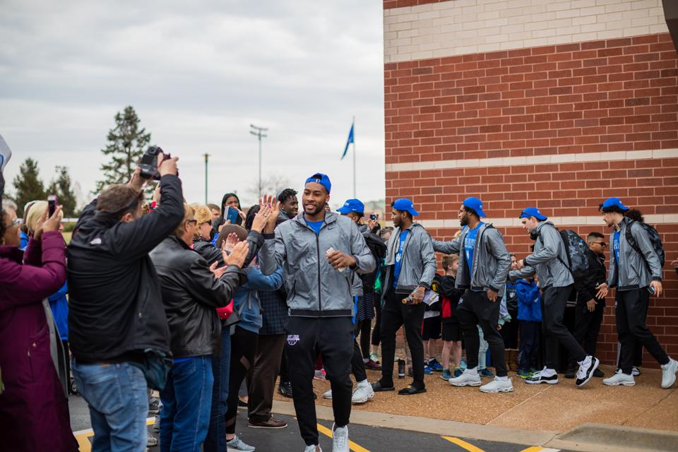 The men's basketball team engages with SLU community before heading off to the first round of the NCAA Tournament. Photo by Garrett Canducci.