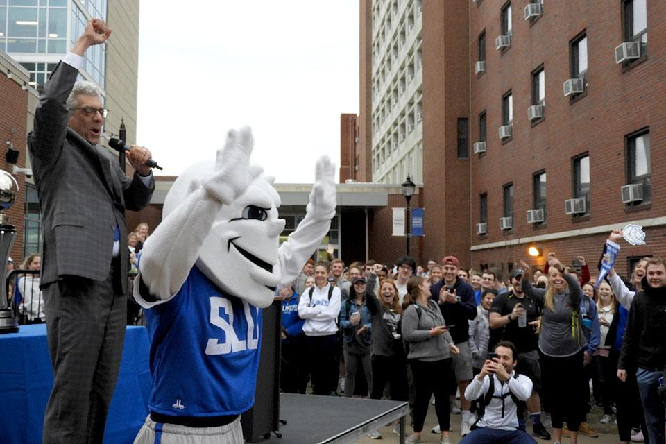 The Billiken celebrates his lucky lottery number and trip to San Jose.