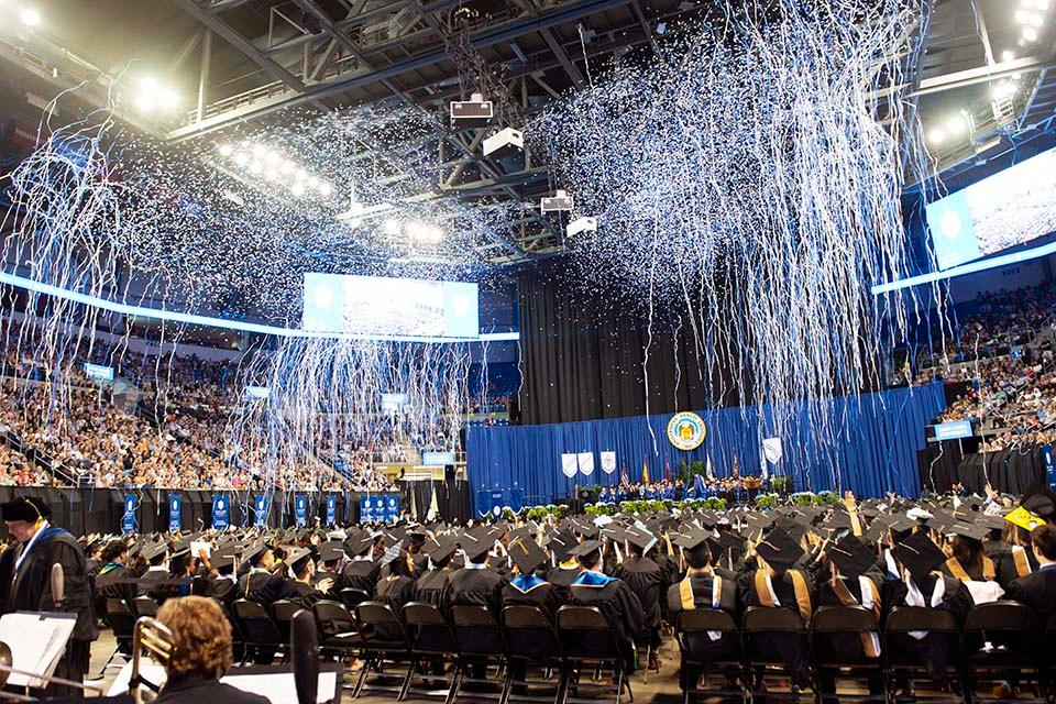 Confetti and cheers mark the end of SLU's 2019 spring commencement ceremony at Chaifetz Arena. Photo by Anne Marie Apollo-Noel
