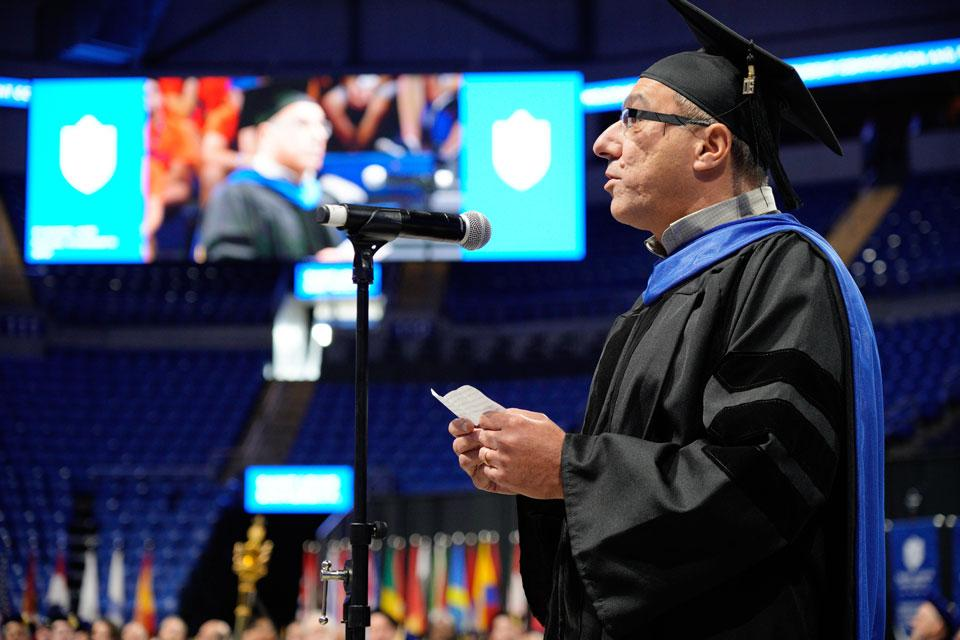 Faculty member and Billiken dad Riyadh Hindi, Ph.D., speaks about how he serves SLU's mission at New Student Convocation.