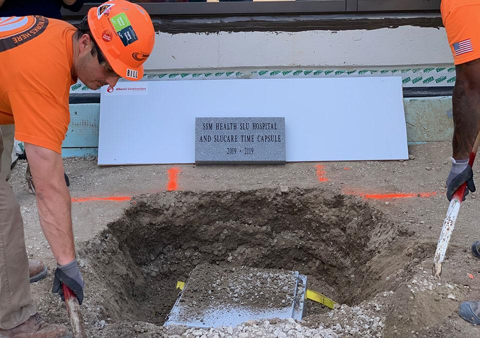 Construction workers bury the 100-year time capsule outside SSM Health Saint Louis University Hospital. Photo by Maggie Rotermund
