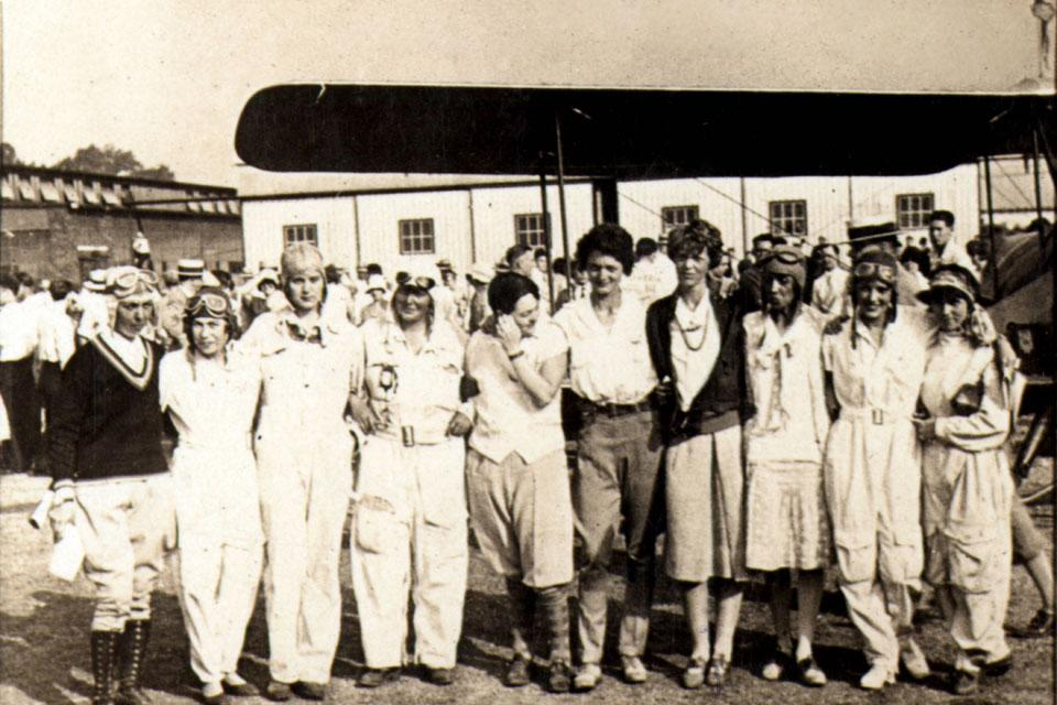 The world's most famous female flyers, including Amelia Earhart (fourth from right) gather at Parks College's field on a stop with the Women's Air Derby in 1929. SLU archival photo