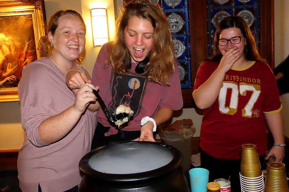 SLUpefy officers make sure the Butter Beer bubbles at the club's Sorting Hat Ceremony.