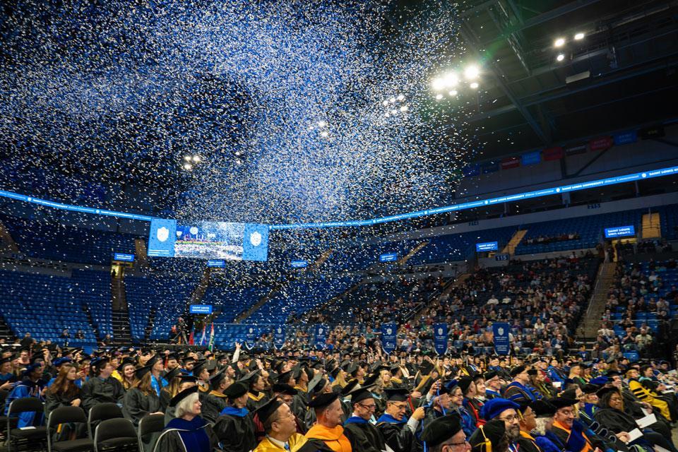 The confetti flies to celebrate SLU's newest alumni. Photo by Steve Long