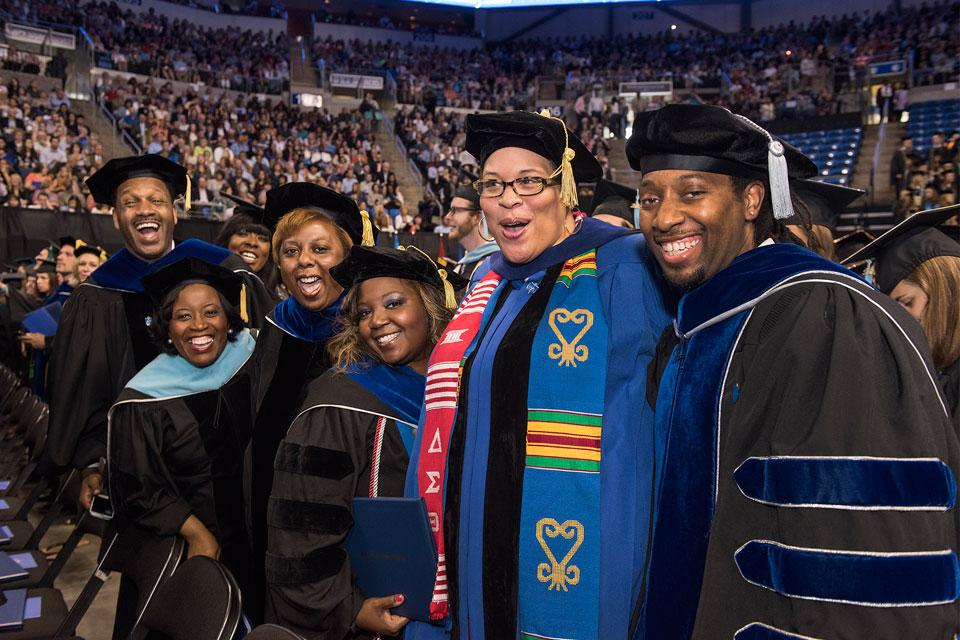 SLU graduates grin with pride at Commencement 2017. Photo by Steve Dolan