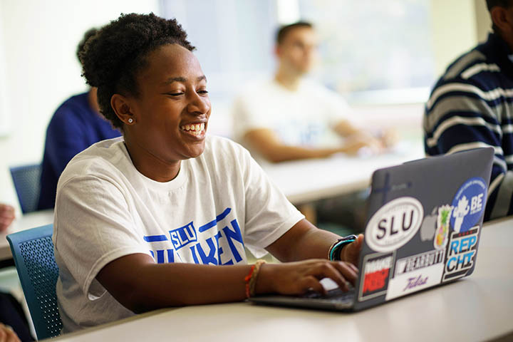SLU female student with laptop