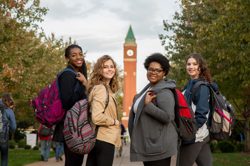 students by clock tower