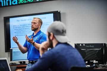 Professor Doellman teaches a finance class at the Chaifetz School of Business.