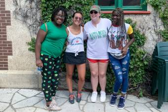 Allison Hallums (second right) and Caroline Schaupp, another service leadership member and volunteer at BBS (second left), spending the day with both their Littles at Grant's Farm.