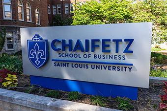 A sign that says CHAIFETZ SCHOOL OF BUSINESS | SAINT LOUIS UNIVERSITY, located outside SLU's business school.