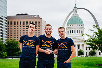 Founders of Mission Control and alum of the Chaifetz School of Business pose with St. Louis' gateway arch and historic courthouse in the background.