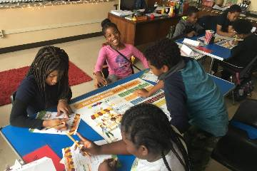 students and staff from across Saint Louis University to teach Junior Achievement business concepts