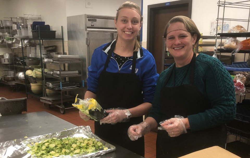 CHS members prepping meals at Campus Kitchen