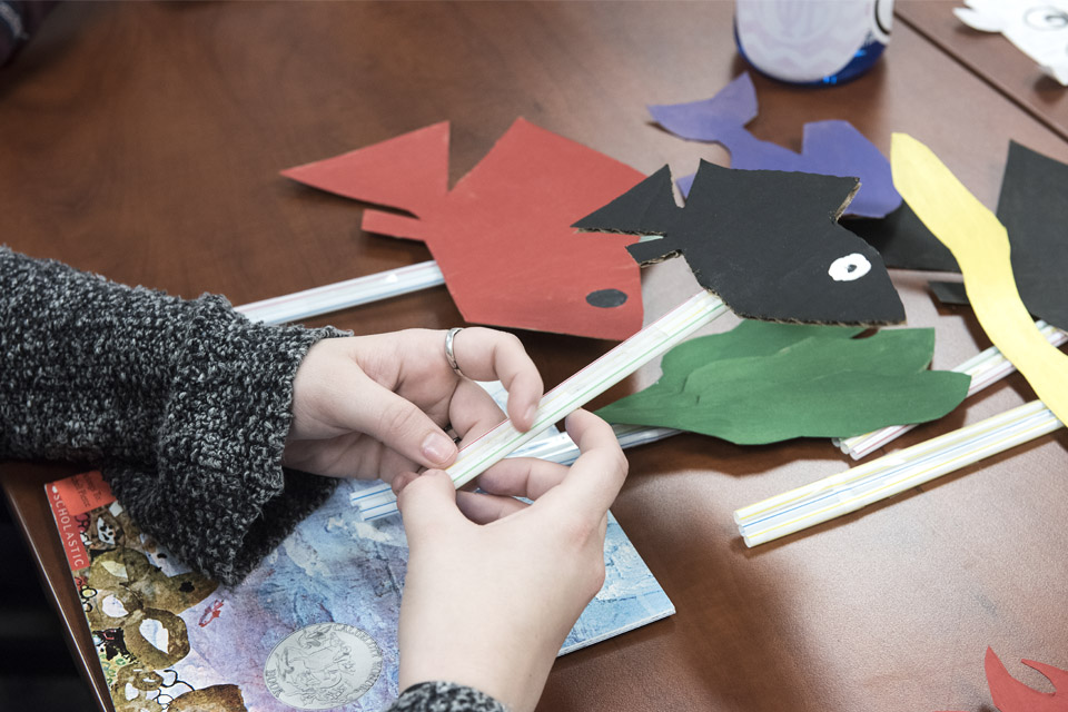 Students create crafts as part of an education curriculum.