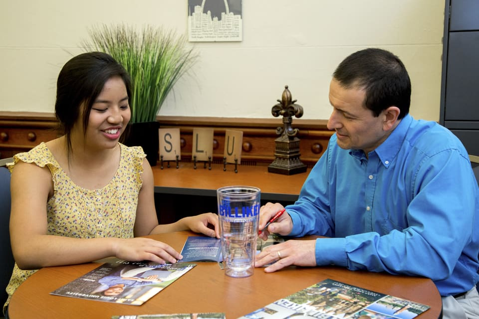 Student works with financial aid counselor