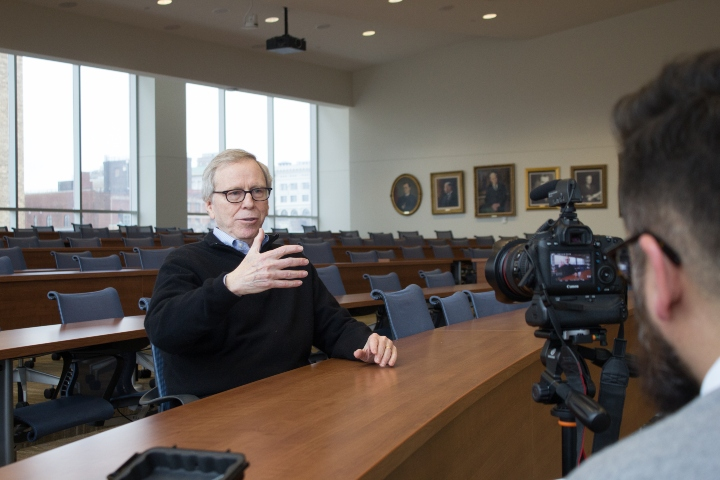 Professor Roger Goldman speaks with a reporter.