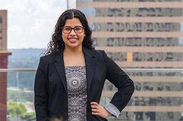 Third-year law student Hiba Al-Ramahi stands on SLU School of Law balcony