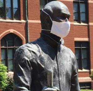 Saint Ignatius statue wearing a surgical mask