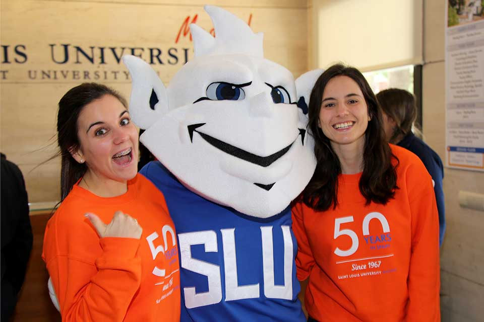 Students with Billiken during 50th anniversary celebration.