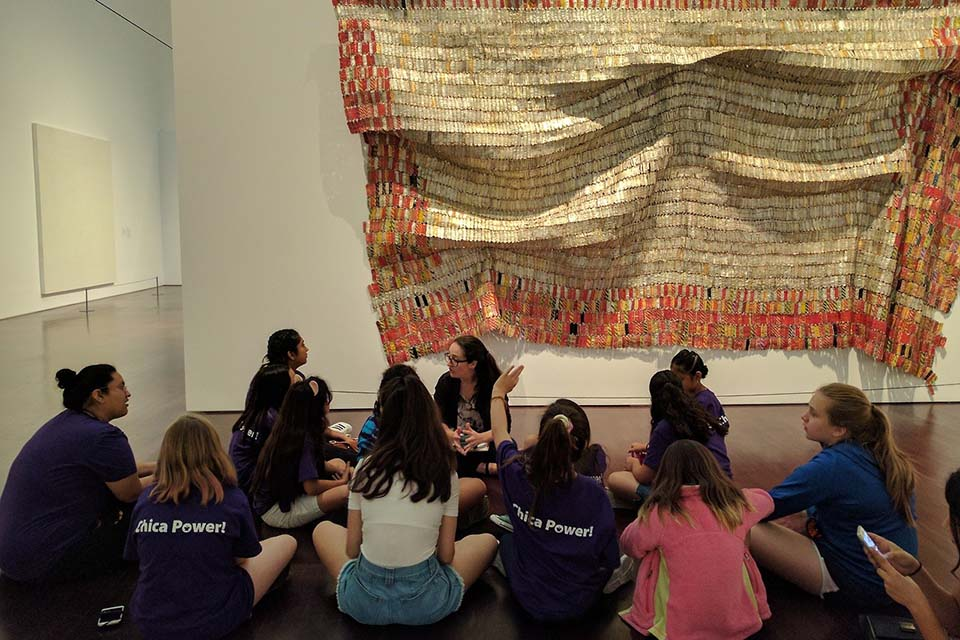 Williamson leads group activity in art gallery.