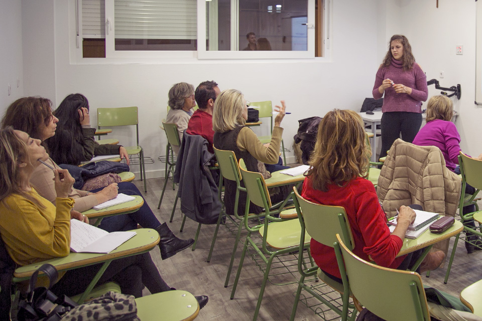 Community ESL volunteers teach free English classes.