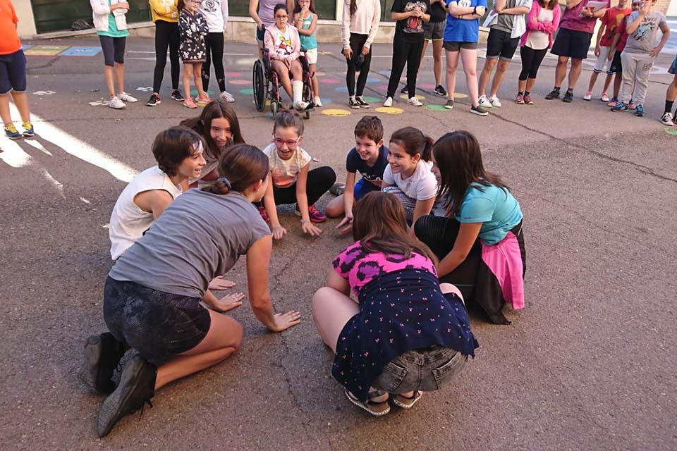 Student volunteers connect with local children in the village of Puertollano.