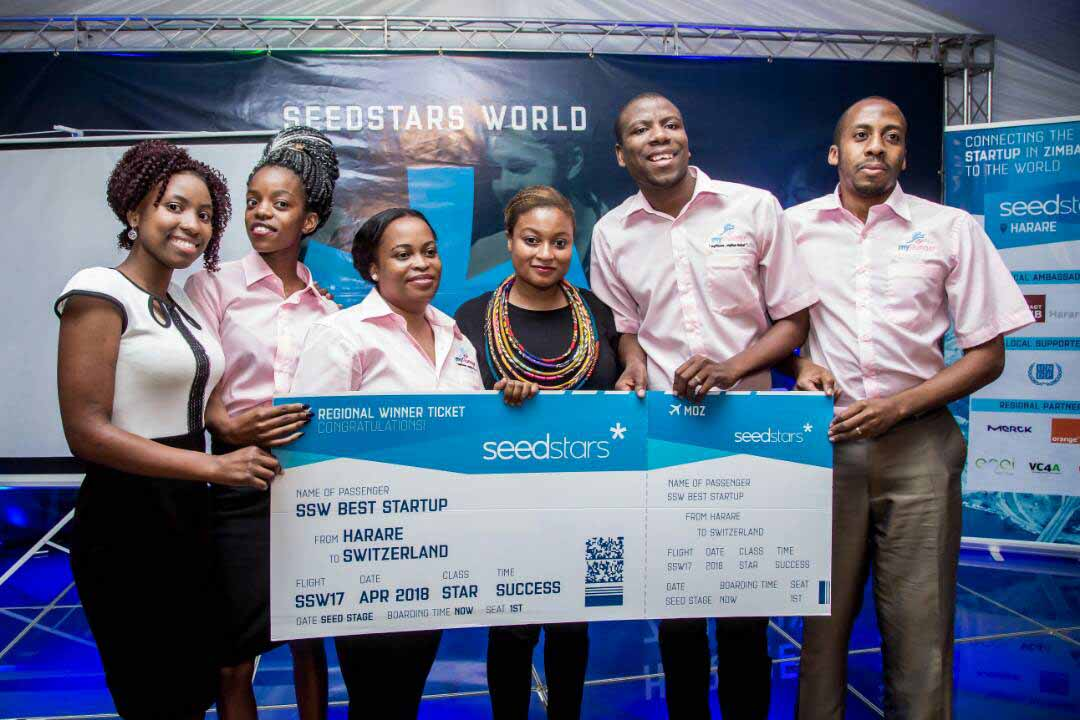 Tadzoka poses for a photo with members of a tech startup honored by Seedstars.