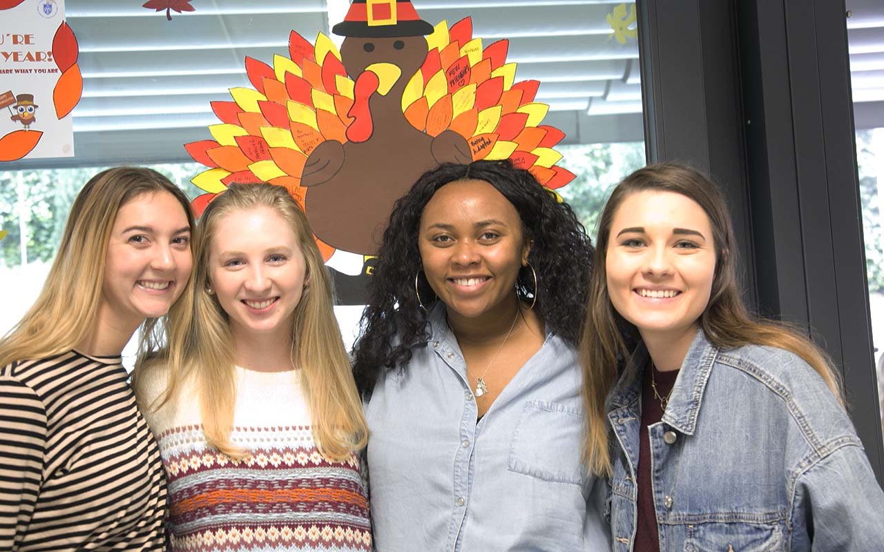 Visiting students enjoy a turkey dinner in the SLU-Madrid cafeteria.
