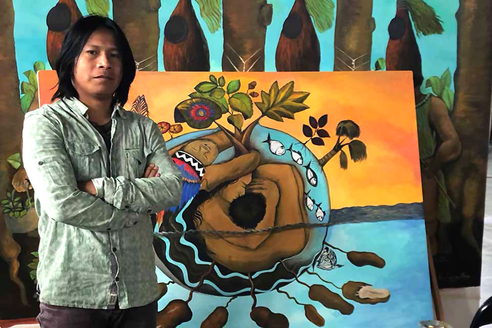 Peruvian artists Brus Rubio poses in front of one of his works of art.
