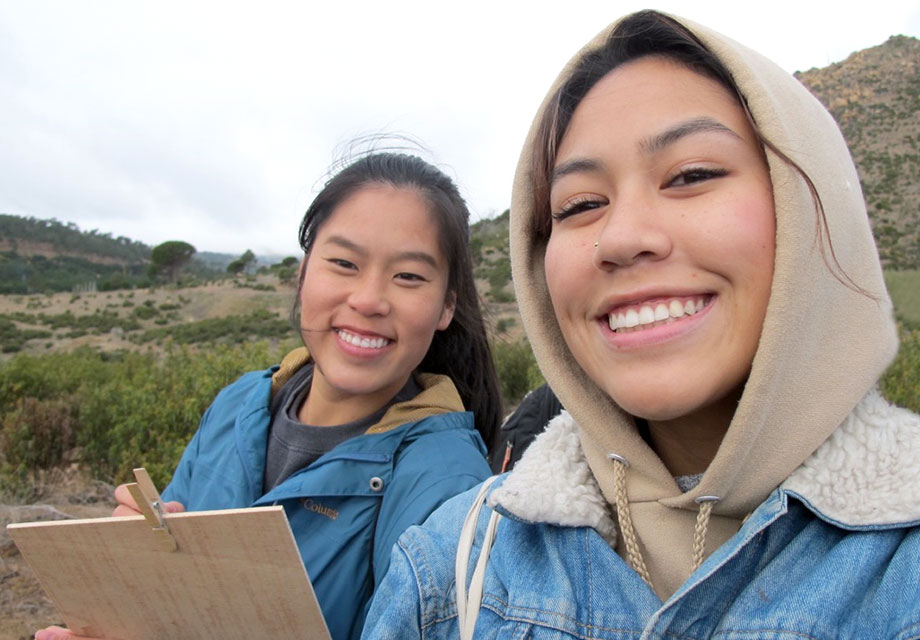 Maude Wilkinson and Adriana Wong collect data on how many of the re-planted trees have survived as part of the ecological restoration of Robledo de Chavela.