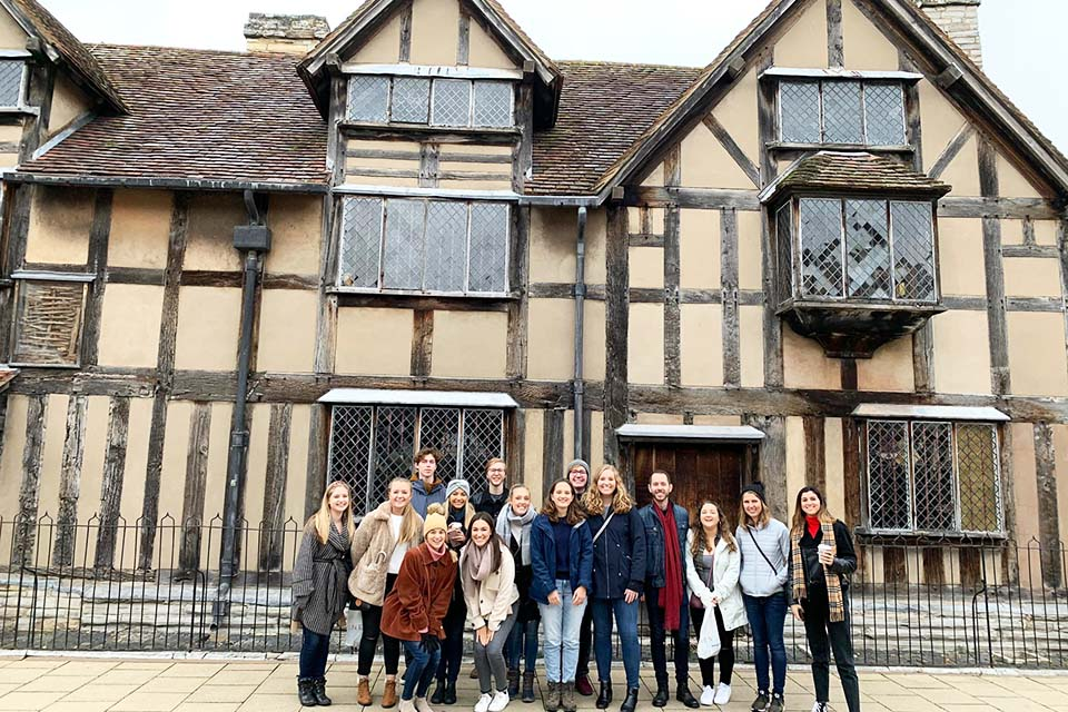Group photo in front of Shakespeare's place of birth.