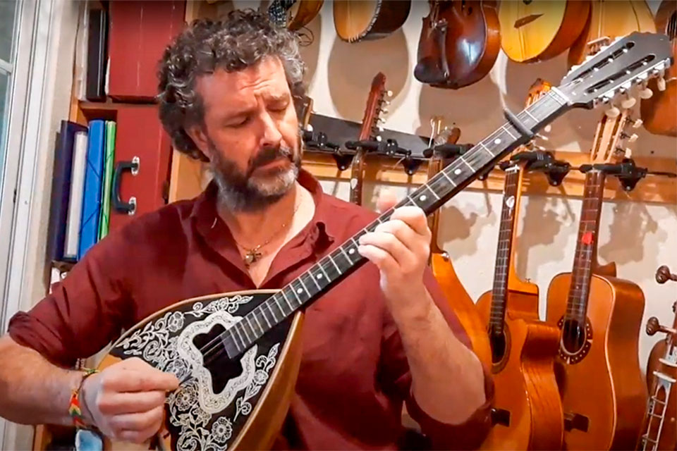 Hamish Binns with musical instruments at his home in central Madrid.