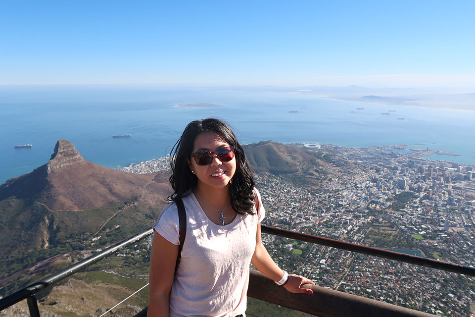 Abad had always dreamed of working for a global organization. Her work in the financial services industry has taken her to many parts of the world. An avid traveler outside of work as well, she poses for a photo during a recent trip she took to Johannesburg, South Africa.