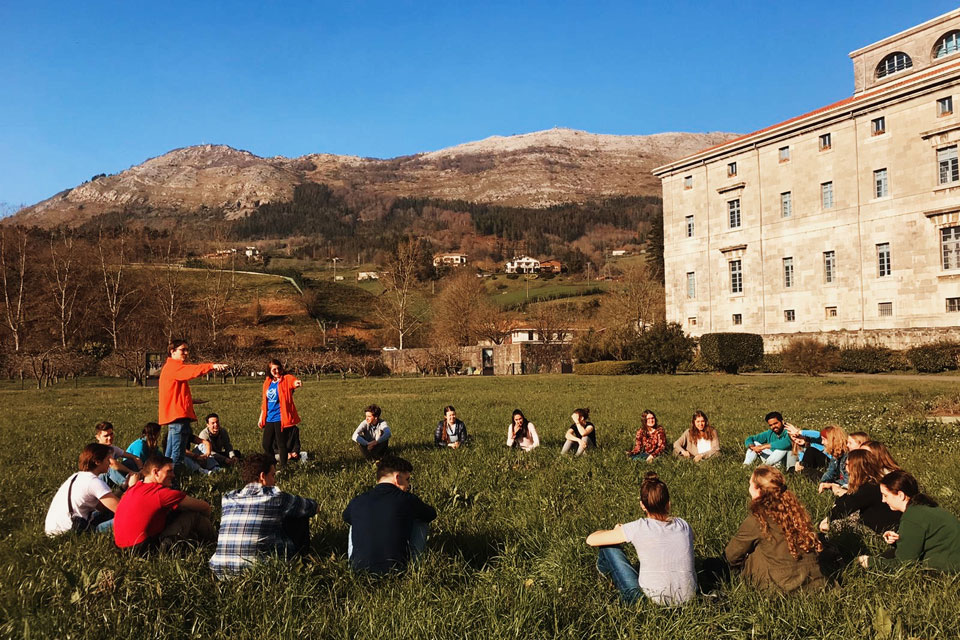 Retreatants gather for a moment of fellowship on SLU-Madrid's Loyola Ignatian Pilgrimage Retreat with the hills of Spain's Basque Country.
