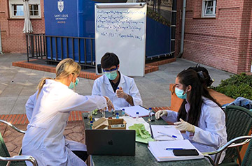 Gustavo Saluste, Ph.D., takes his General Chemistry I lab outdoors for a lab session.