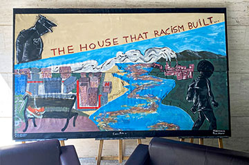 At the mural painting workshop, students designed a mural focusing on how housing discrimination has been historically radicalized.