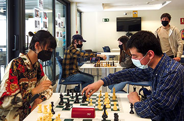 Chess Club president Alexander Sprague and vice-president César Gallardo review game strategies with players before the start of the Spring 2021 Rapid Arena Tournament.