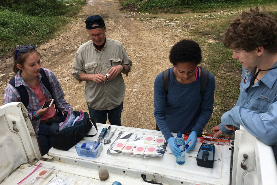 The group tests water samples in Belize
