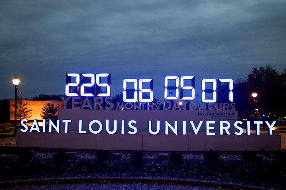 The clock stopped at 225 years, 6 months, 5 days, and 7 hours of service completed by SLU students, alumni, faculty, staff and community members.