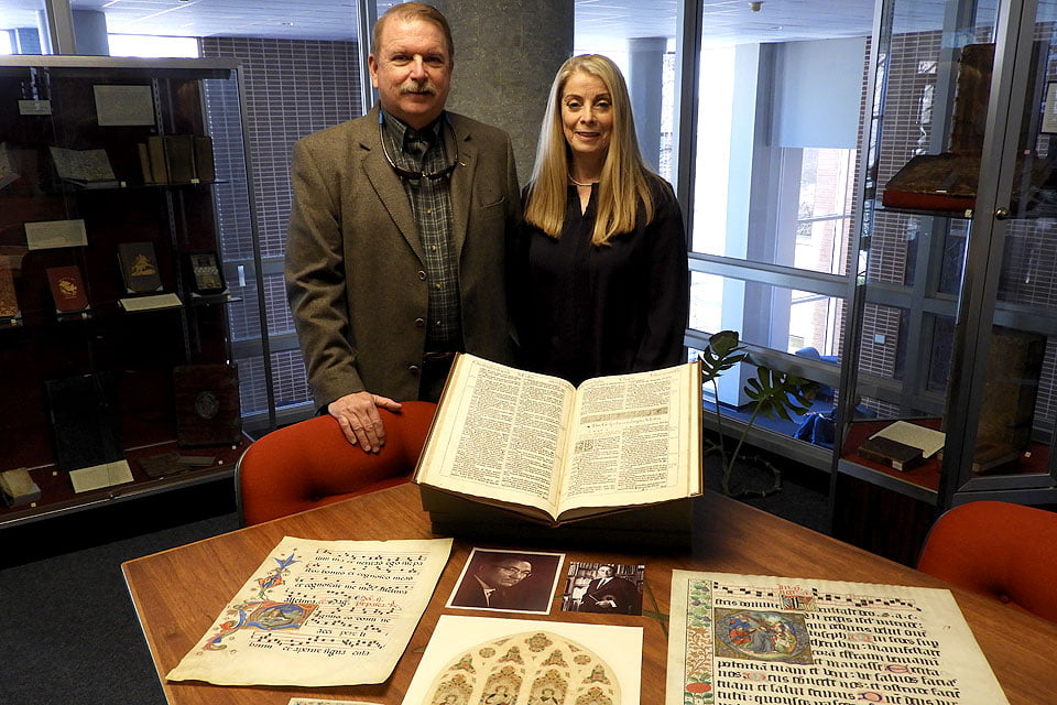 Jeff Edwards, Ph.D. and his wife, Shelby, in the library