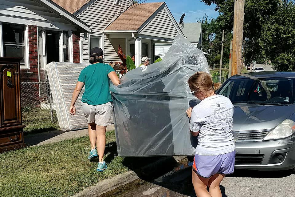 Rimmerman and other volunteers help someone move in