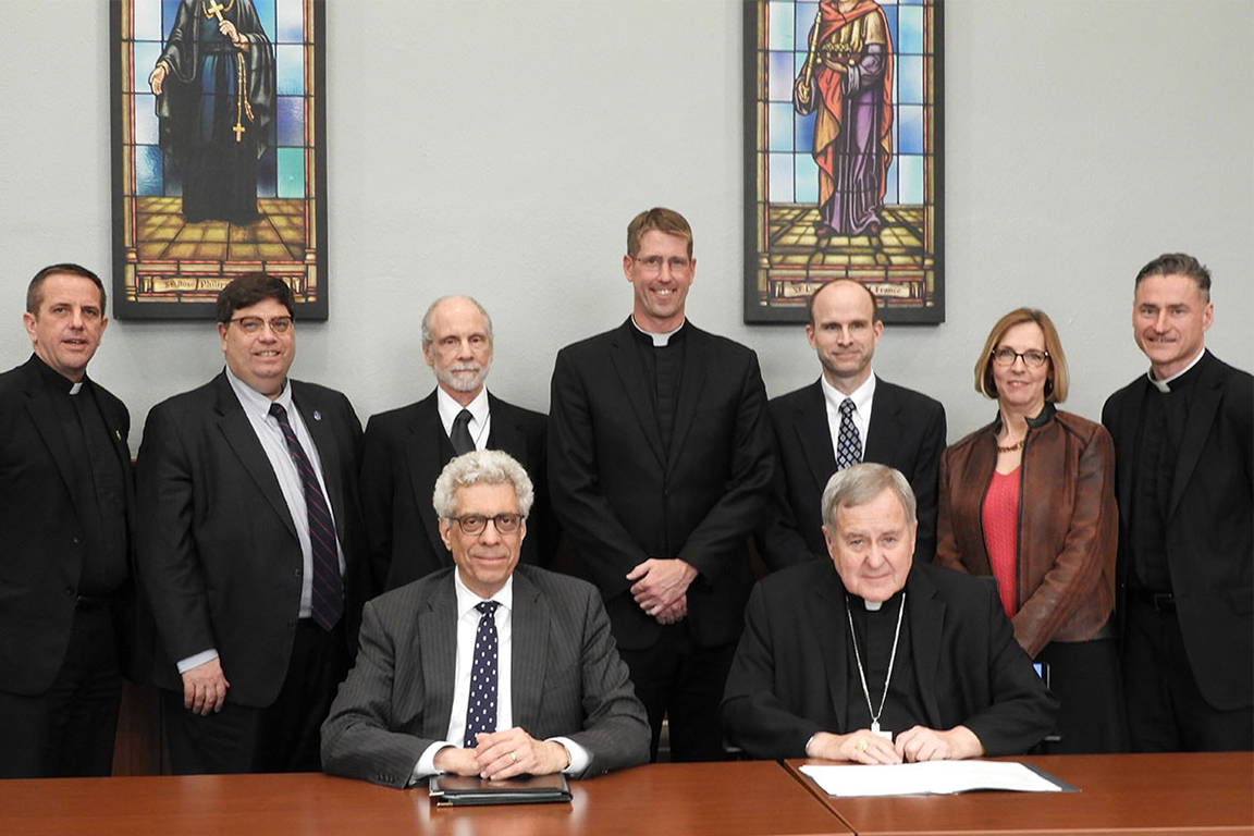 St. Louis Archbishop Robert J. Carlson and Fred Pestello, Ph.D., president of Saint Louis University, signed an agreement on Monday, April 23, that brings the Kenrick-Glennon Seminary undergraduate program fully into SLU's College of Philosophy and Letters.
