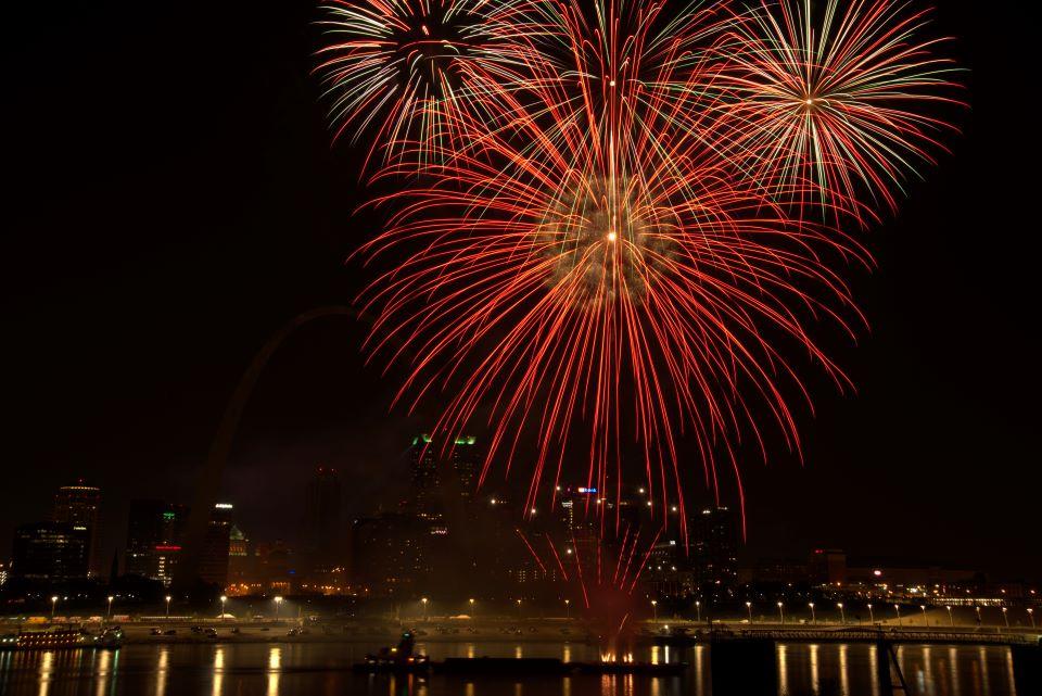 Fireworks explode over the Mississippi River following SLU's Bicentennial Mass.