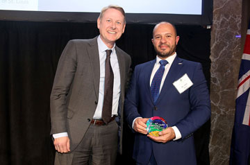 Hadi Alhorr, Ph.D., receives an award on behalf of the Boeing Institute of International Business.