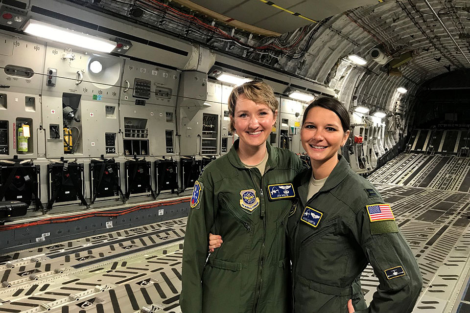 Alicia Canetta (right) joins a colleague inside an Air Craft plane.