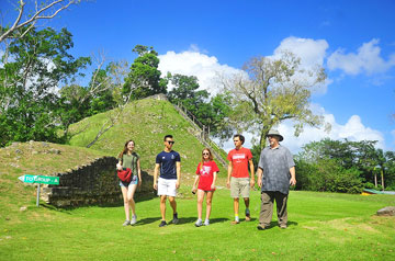 SLU students tour a cultural site in Belize.