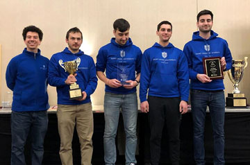 Saint Louis University's Chess Team poses with a trophy after qualifying for the Final Four of Chess.
