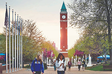 Students walking near the clock tower.